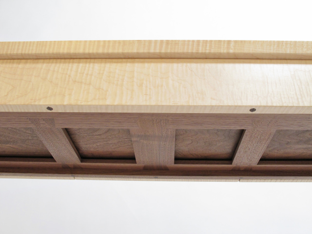 Our Three Drawer Entry Table features a uniquely designed interlocking web support system for the drawers.  Hand-cut dovetails make the bottom of this table as lovely as the top