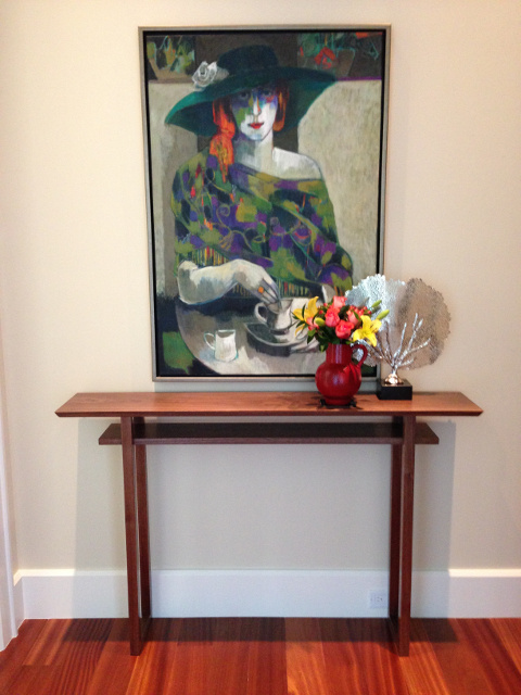 Our walnut console table in the home of a happy customer!  This narrow wood table is in the hallway of a Florida home and is a beautiful artistic addition to the space
