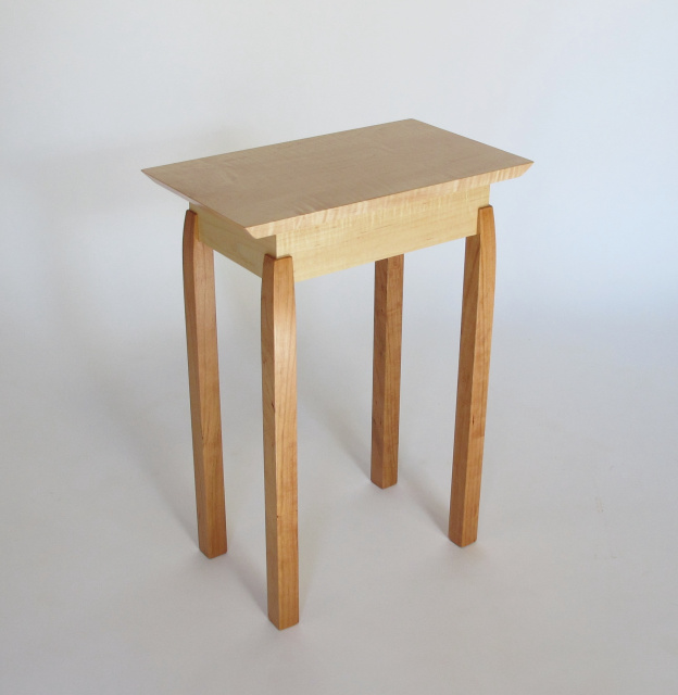 Exposed Leg End Table by Mokuzai Furniture- a small narrow end table with unique joinery details- a solid wood accent table in tiger maple and cherry- handmade in the USA