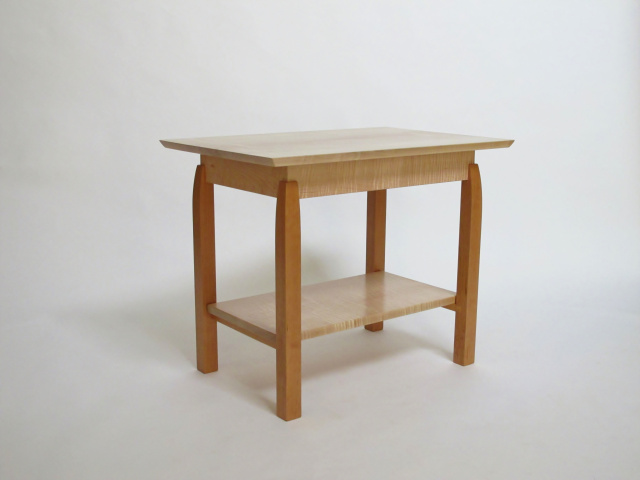 A modern wood side table with low shelf- pictured here in tiger maple and cherry this modern wood furniture design is a lovely accent table, occasional table or even a small coffee table.  Custom Table orders welcome.