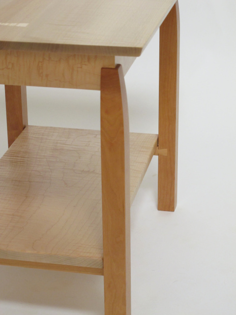 Beautiful dovetail stretchers support the low shelf on this modern wood furniture design.  A lovely accent table, occasional table, side table or coffee table this solid wood table offers storage or display