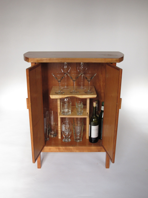Cherry Bar Cabinet, unique glassware and closed liquor cabinet storage