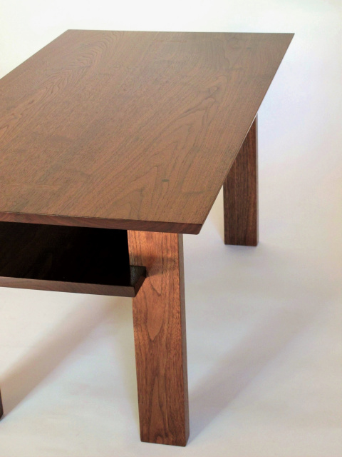 A handmade narrow wood coffee table with inset shelf for storing remotes, magazines and more