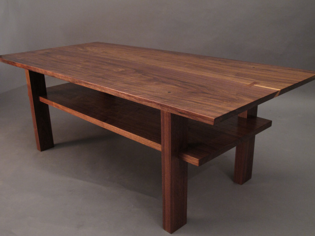 Artistic Solid Wood Coffee Table With Inset Shelf A Walnut Coffee Table For Modern Interiors