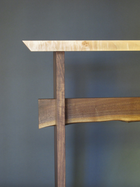 A live edge stretcher make this standing desk uniquely beautiful