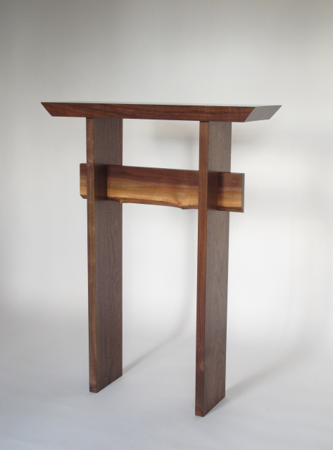 Statement table in solid walnut with live edge stretcher for Tall console table
