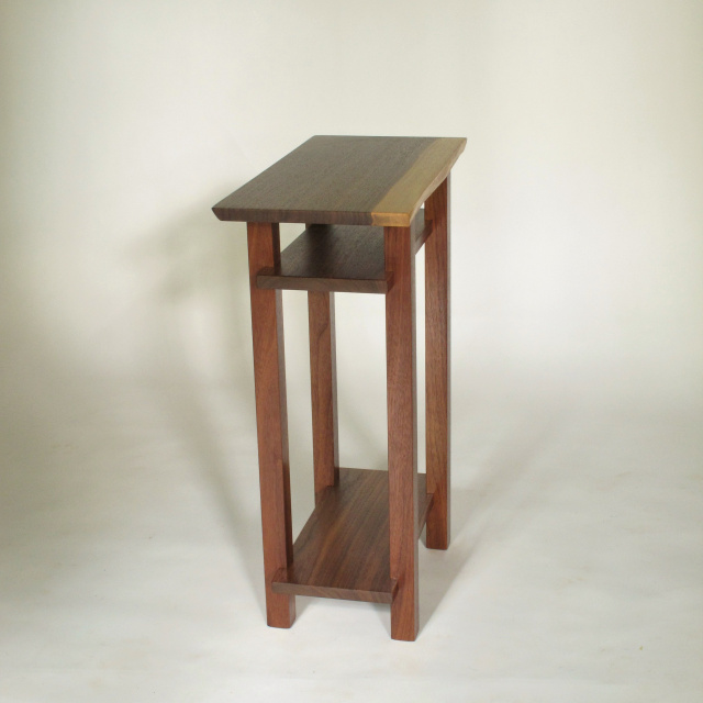 a narrow table with live edge table top. Handmade from solid walnut, this small end table is great for tight spaces.  The live edge table top is unique.