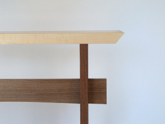 A gentle curve on the stretcher for our Statement Hall Table- a narrow hallway console made from tiger maple and walnut