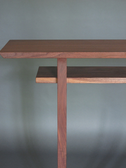 A walnut console table with beautiful grain patterns