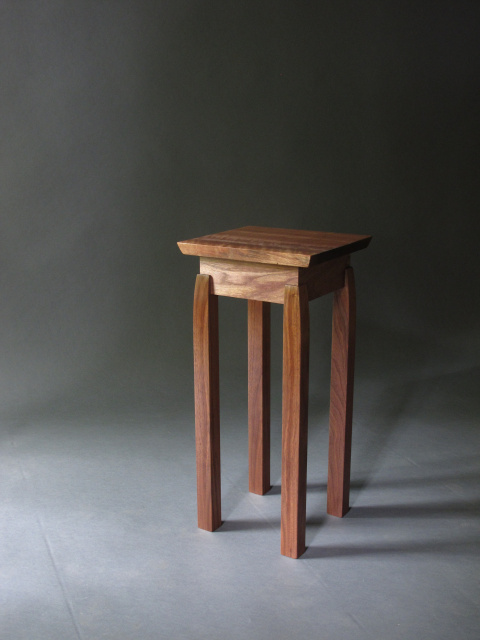 a small wooden accent table with modern style lines- handmade wood table pictured in solid walnut