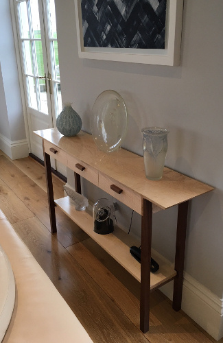 a console table with three drawers, narrow wood table with drawers handmade from solid wood pictured in tiger maple and walnut