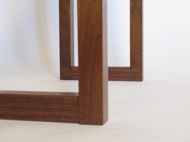 hand-cut dovetails left visible at the foot of this narrow console table- handmade wood furniture for the entryway