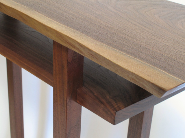 hand-cut joinery of the inset shelf and a unique grain pattern detail at the shelf corner