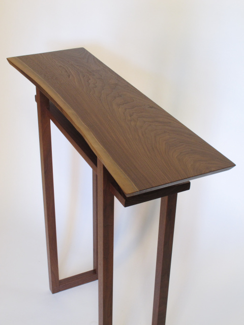 A narrow walnut table with live edge table top for a hallway table or entry table- modern minimalist furniture design