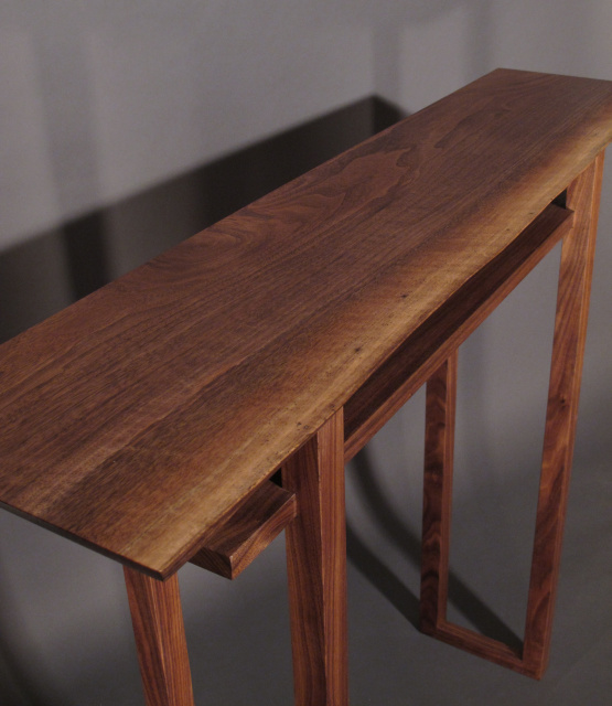 A narrow hall table with live edge table top- walnut wood furniture handmade in the USA by Mokuzai Furniture with mid century modern furniture styling