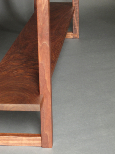 hand-cut joinery details of the dovetail feet on our long narrow console table with two shelves