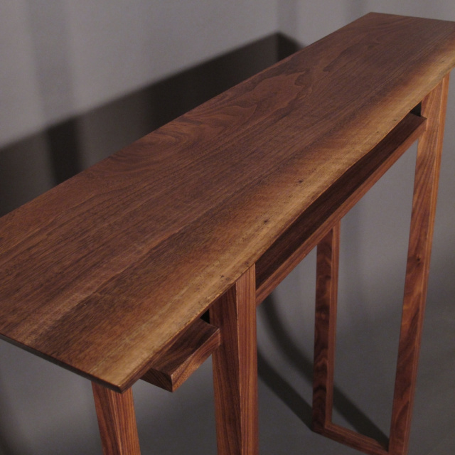 A narrow hall table with Live edge table top in Walnut- mid century modern furniture design for an entry console table, for narrow hallways, or narrow side tabel